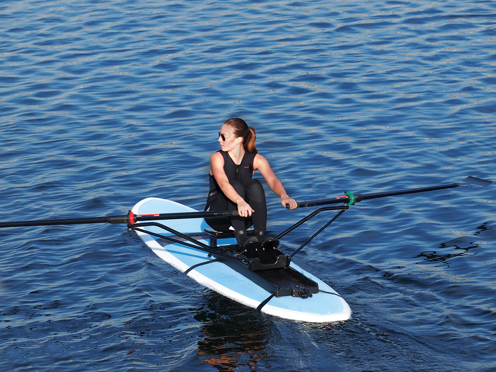 Oar Board® Fit On Top Rower turns any paddleboard, 10′ or longer, into a performance sculling rowing machine.